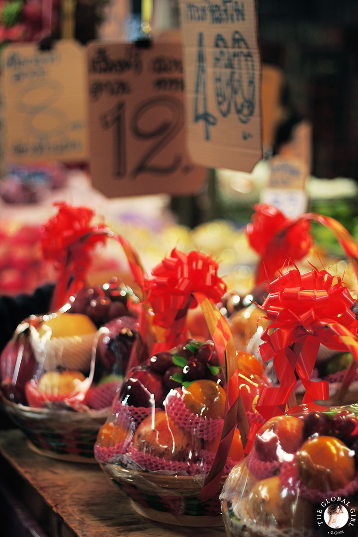 The Global Girl Travels: Colorful fruit baskets at Khlong Toey market in Bangkok, Thailand.