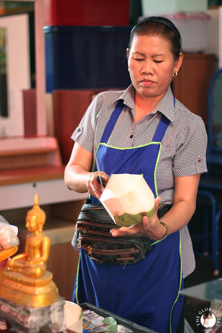 The Global Girl Travels: Young Thai coconuts at Khlong Toey market in Bangkok, Thailand.