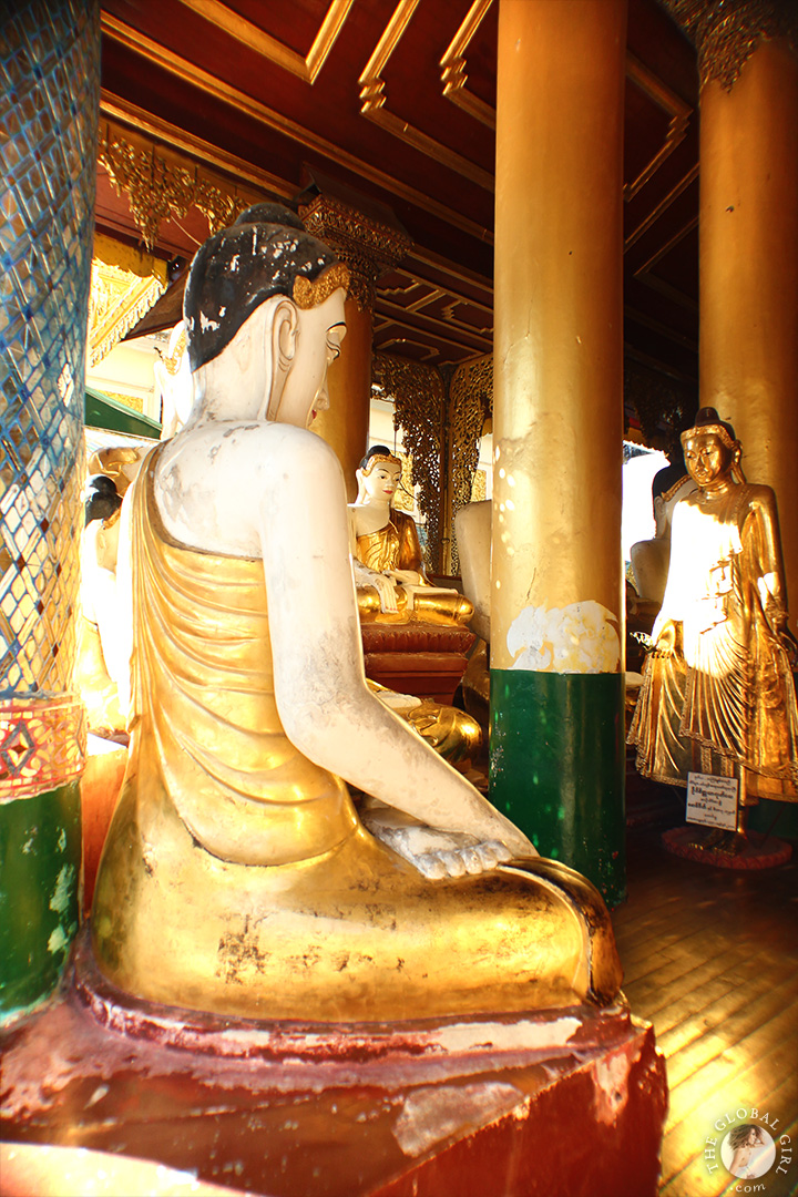 The Global Girl Travels: Gold Buddhas at the Shwedagon Pagoda in Yangon, Myanmar.