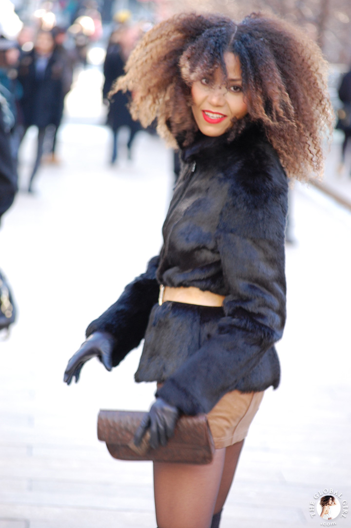 New York Fashion Week Street Style: Ndoema rocks her trademark natural hair with a cozy faux fur jacket, claw belt and ostrich embossed leather clutch.