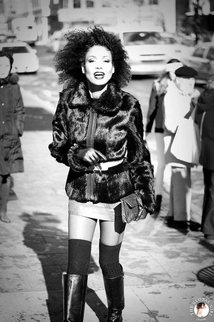 New York Fashion Week Street Style: Ndoema rocks her trademark natural hair with knee high wedge boots by Ash, a Diesel leather mini skirt and faux fur jacket.