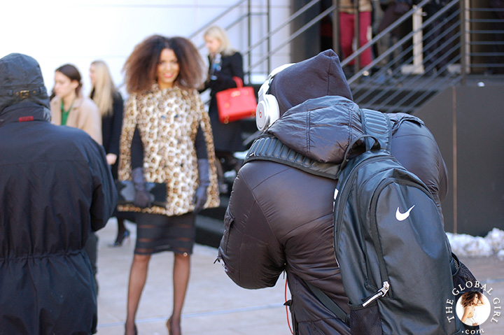 Ndoema arrives at New York Fashion Week in a bold leopard print cape and crocodile clutch.