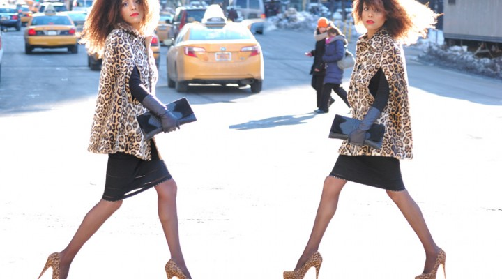 New York Fashion Week Street Style: Ndoema goes for animal prints in leopard cape and matching platform pumps.