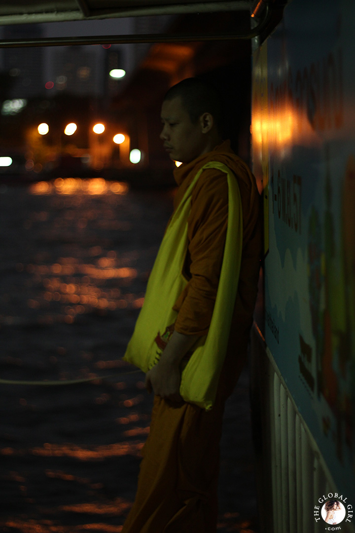 The Global Girl Travels: A meditative monk on the Chao Phraya river in Bangkok, Thailand.
