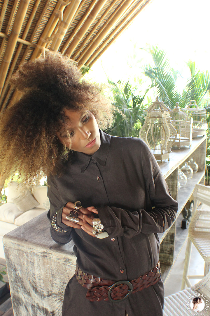 The Global Girl Travels: Ndoema in a Dries Van Noten linen maxi shirt dress with braided leather belt and sterling silver & quartz crystal jewelry amidst modern bamboo architecture at Glamping Hub 's luxury safari tents in Ubud, Bali.