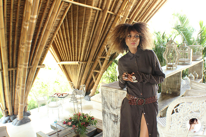 The Global Girl Travels: Ndoema in a Dries Van Noten linen maxi shirt dress with braided leather belt amidst modern bamboo architecture at Glamping Hub 's luxury safari tents in Ubud, Bali.