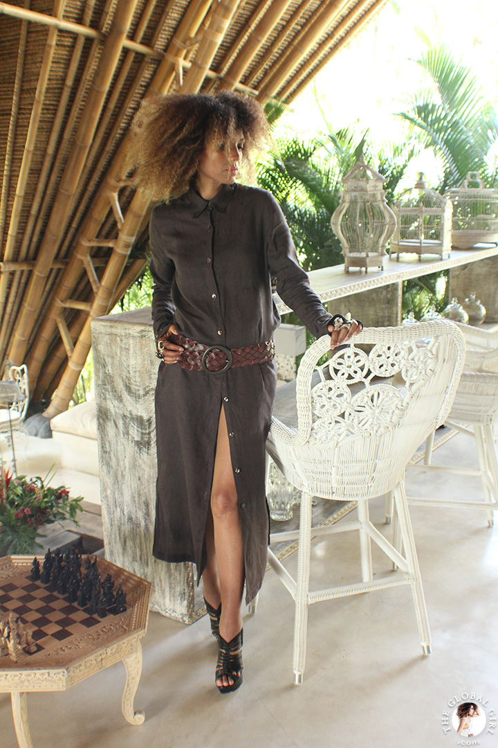 The Global Girl Travels: Ndoema in a Dries Van Noten linen maxi shirt dress amidst modern bamboo architecture at Glamping Hub 's luxury safari tents in Ubud, Bali.