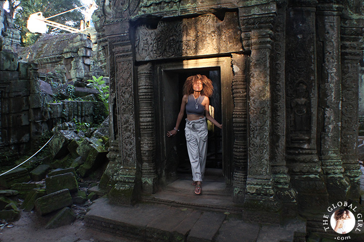 The Global Girl Travels: Ndoema strolls through the ruins of Ta Prohm's jungle temple in Cambodia.