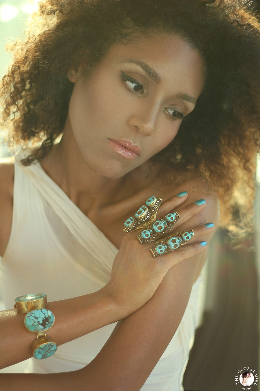 The Global Girl Fashion: Ndoema sports multiple turquoise and brass skull rings with a matching oversized bracelet.