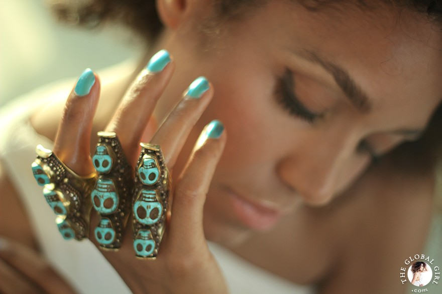 The Global Girl Fashion: Ndoema sports multiple turquoise and brass skull rings.