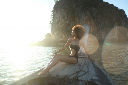 The Global Girl Travels: Ndoema sports a cut out swimsuit while sailing in the Phang Nga Bay in Thailand.