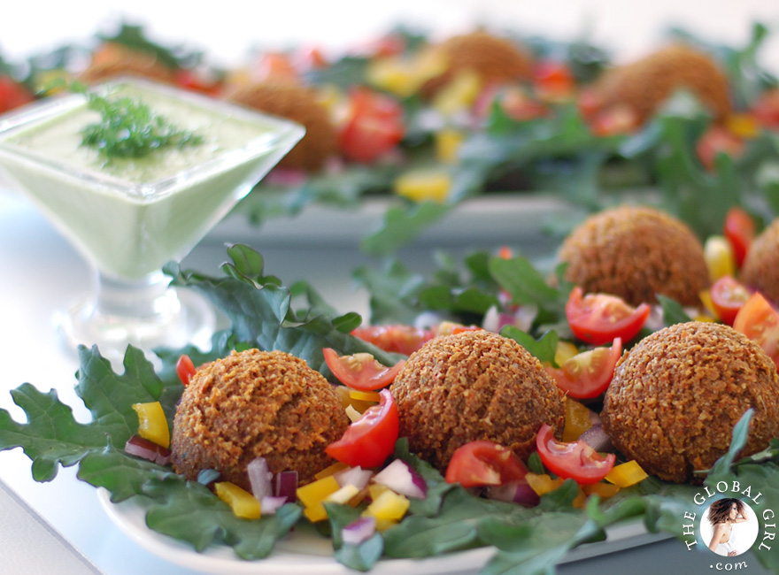 The Global Girl Raw Middle Eastern Recipes: These raw falafels with creamy tatziki sauce are the healthiest way to satisfy your Middle Eastern food cravings. 100% raw, vegan, dairy free, gluten free and low fat.