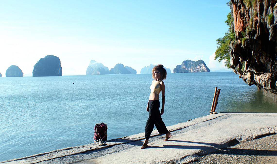 The Global Girl Travels: Ndoema sports a gold crop top with cat eye sunglasses while exploring beautiful James Bond Island in the Phang Nga Bay, Thailand.