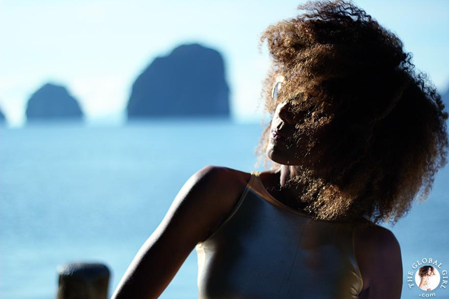 The Global Girl Travels: Ndoema sports a gold crop top with rasoir cat eye sunglasses while exploring beautiful James Bond Island in the Phang Nga Bay, Thailand.