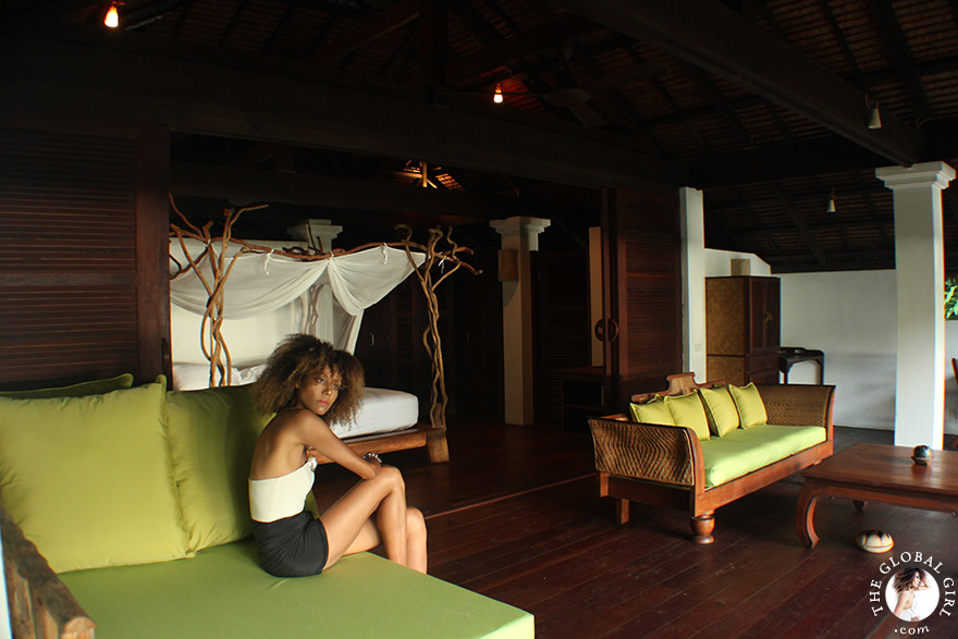 The Global Girl Travels: Ndoema greets the sunrise in her open style bedroom at Glamping Hub's eco-friendly resort in Ko Yao Noi, Southern Thailand.