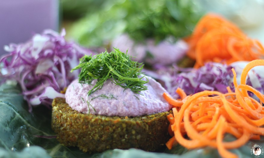 The Global Girl Raw Food Recipes: Carrot & Dill Burgers in collard green leaf with shredded red cabbage, romaine lettuce and carrots. 100% raw, vegan and gluten-free.