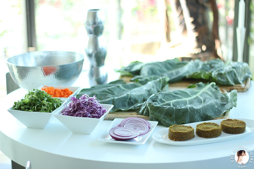 The Global Girl Raw Food Recipes: Carrot & Dill Burgers in collard green leaf with shredded red cabbage, romaine lettuce, carrots and red onion. 100% raw, vegan and gluten-free.