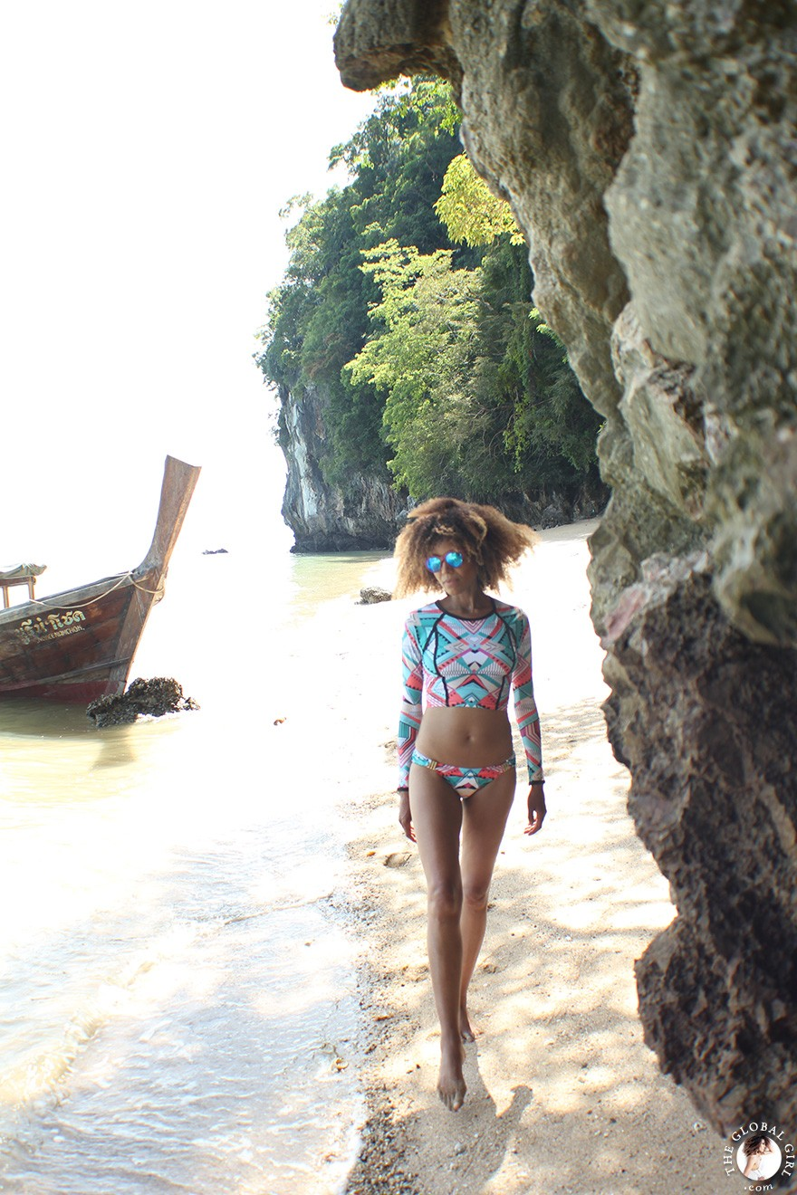 The Global Girl Travels: Picture perfect private island in the Phang Nga Bay off Koh Yao Noi, Thailand. Ndoema sports a geometric-print rashguard and bikini set with cat eye mirrored sunglasses.
