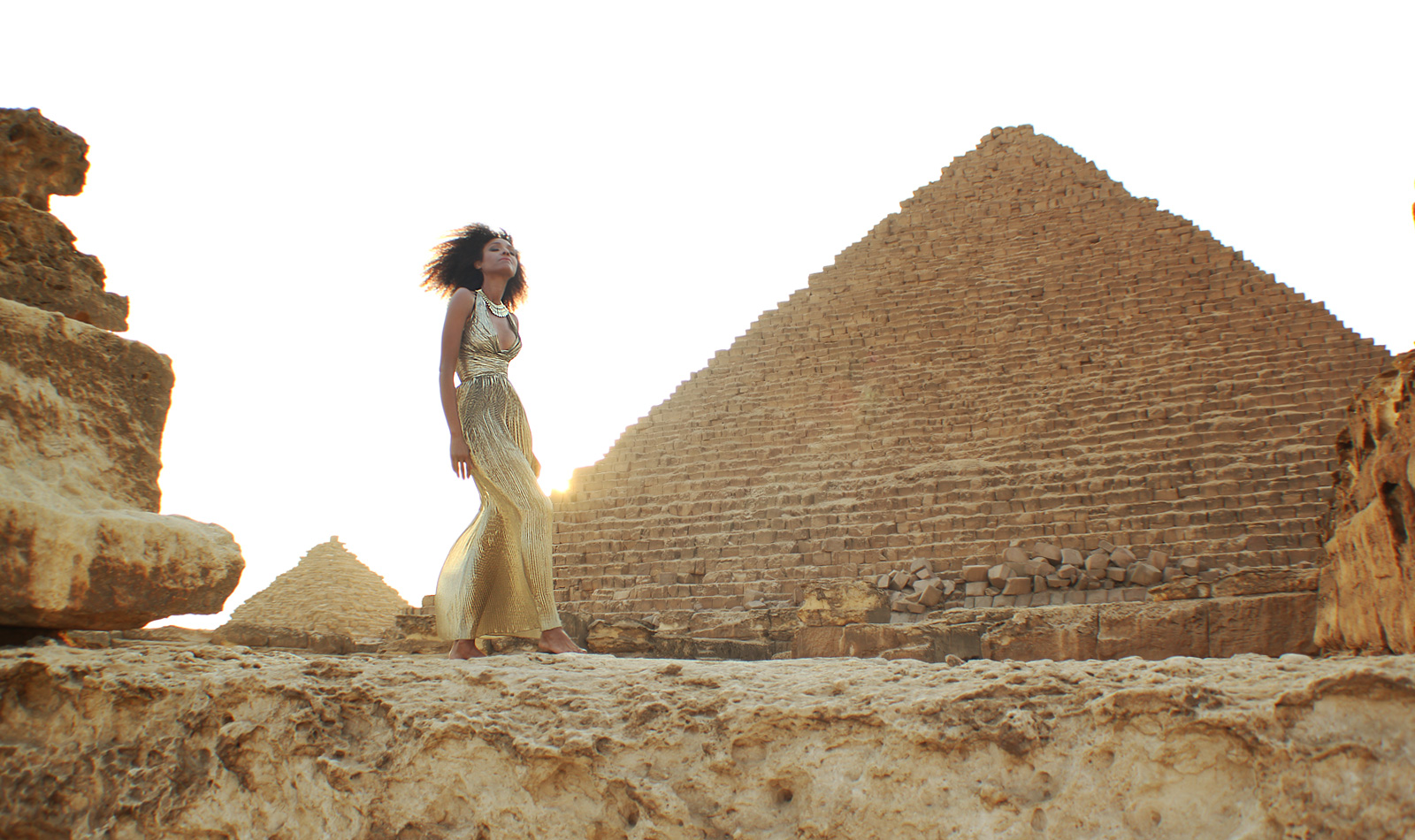 Ndoema in a goddess gold lame gown at the giza pyramids in egypt ndoema in a goddess gold lame gown at the giza pyramids in egypt the global girl kristyandbryce Choice Image