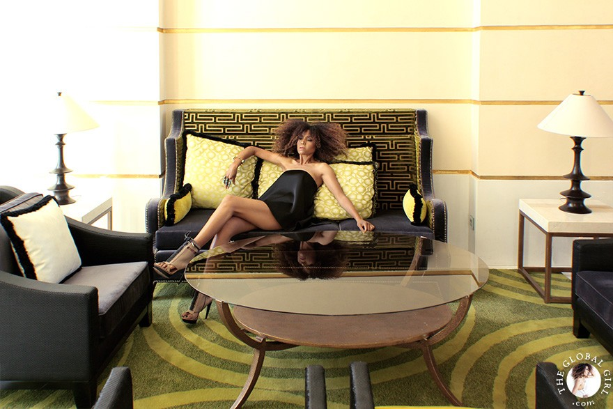 The Global Girl Daily style: Ndoema in a black flounce bustier top, Alexander Wang skort and gladiator open-toe booties at The Sofitel Legend Old Cataract Hotel in Aswan, Egypt.