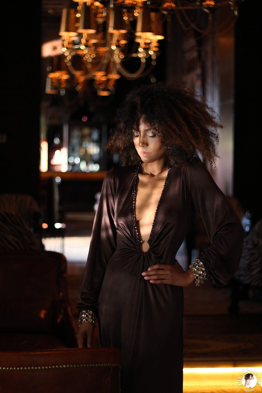 The Global Girl Fashion Editorials: Ndoema channels neo-aristocratic chic in a vintage chocolate brown gown with deep v plunging neckline and custom three-row topaz link bracelets at the Sofitel Legend Old Cataract hotel in Aswan, Egypt.