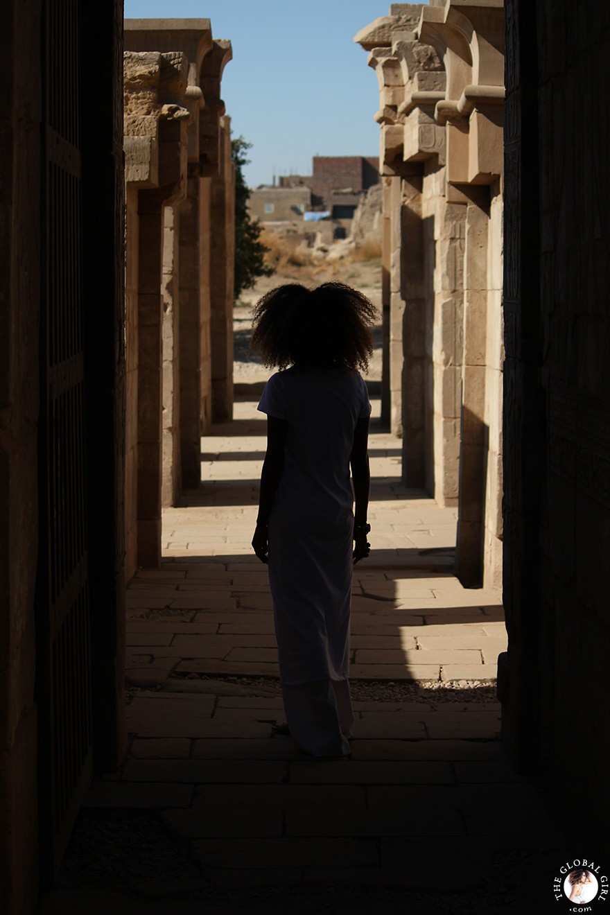 The Global Girl Daily Style: Ndoema sports the all white look at the Karnak Temple in Luxor, Egypt.