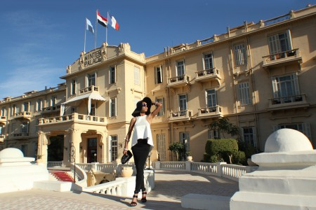 The Global Girl Travels: Ndoema sports a classic black and white hat look at the Sofitel Winter Palace Hotel in Luxor, Egypt.