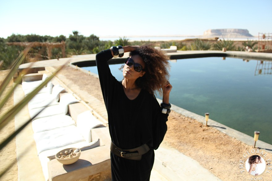 The Global Girl Travels: Relaxed and chic in a Moroccan-inspired batwing dress and tribal bracelets, Ndoema explores desert eco-chic living at luxury eco-lodge Talist at Siwa Oasis in the Libyan desert.