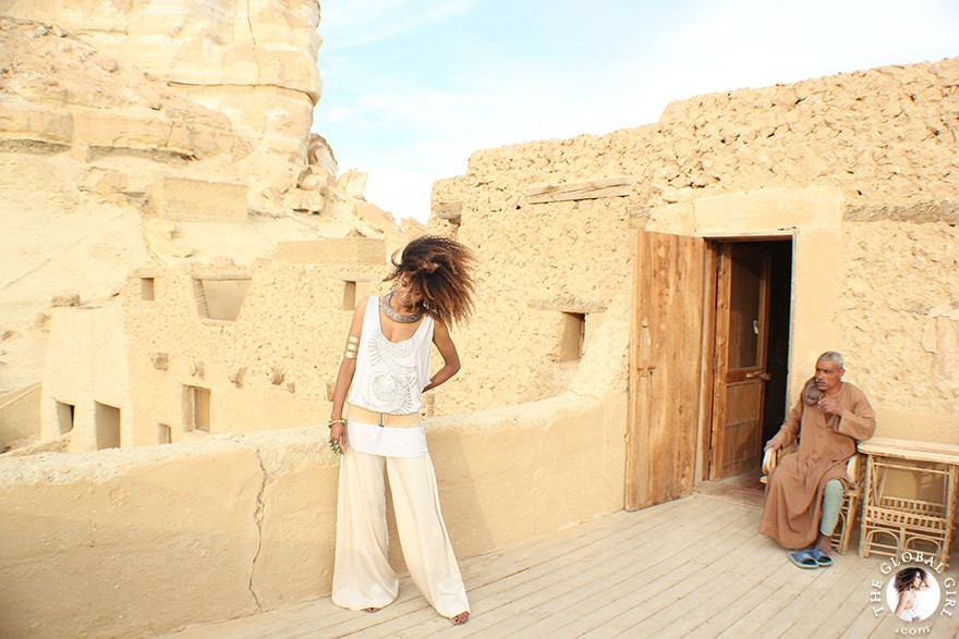 The Global Girl Daily Style: Ndoema channels boho chic style in ethnic-inspired beaded tank by Antik Batik, silk palazzo pants by Robert Rodriguez, jeweled sandals by Miu Miu and her own collection of tribal jewelry. Photographed at the Adrère Amellal luxury eco-friendly desert resort at Siwa Oasis, Egypt.
