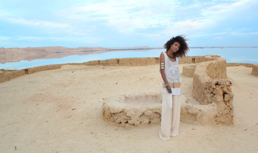 The Global Girl Daily Style: Ndoema in boho chic inspired beaded tank, palazzo pants, jeweled sandals and tribal jewelry. Photographed at the Adrère Amellal luxury eco-friendly desert resort at Siwa Oasis, Egypt.