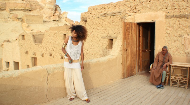 The Global Girl Daily Style: Ndoema channels boho chic style in ethnic-inspired beaded tank by Antik Batik, silk palazzo pants by Robert Rodriguez, jeweled sandals by Miu Miu and her own collection of tribal jewelry. Photographed at the Adrère Amelia luxury eco-friendly desert resort at Siwa Oasis, Egypt.