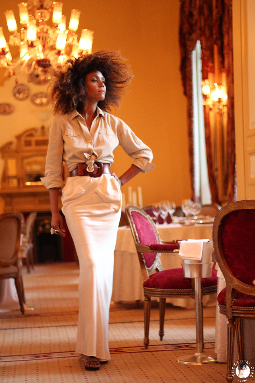 The Global Girl Travels: Ndoema has a princess moment at the 1886 restaurant at the Sofitel Winter Palace in Luxor, Egypt. Ndoema sports a fishtail maxi skirt by Rick Owens with Theory safari shirt and open-toe ankle boots by L.A.M.B.