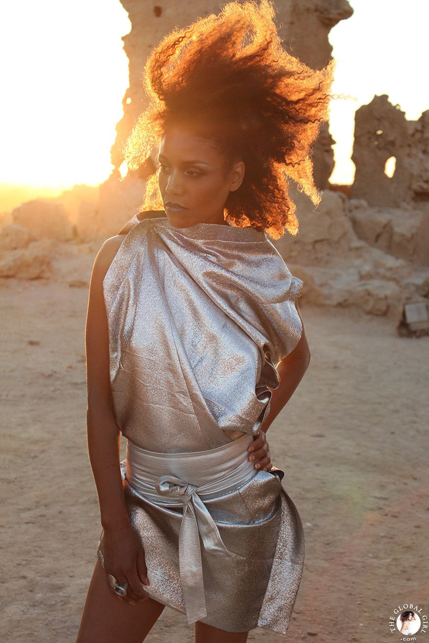 The Global Girl Fashion Editorials: Ndoema goes futuristic in a silver metallic dress by Australian designer Ellery against the ancient ruins of Shali Ghadi, a spectacular 13th-century fortress at Siwa Oasis, Egypt.