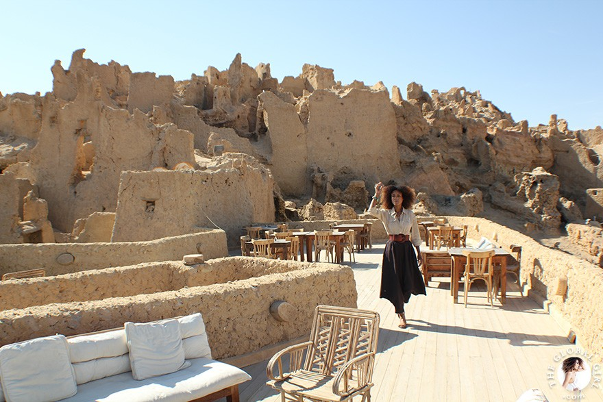 The Global Girl Travels: Ndoema goes monochromatic in earth toned tribal harem pants, safari shirt and ankle tie sandals at the Al-Babinshal Heritage hotel in Siwa, Egypt.
