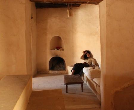 The Global Girl Travels: Ndoema goes monochromatic in earth toned tribal harem pants, safari shirt and ankle tie sandals at the Al-Babinshal Heritage hotel in Siwa, Egypt.