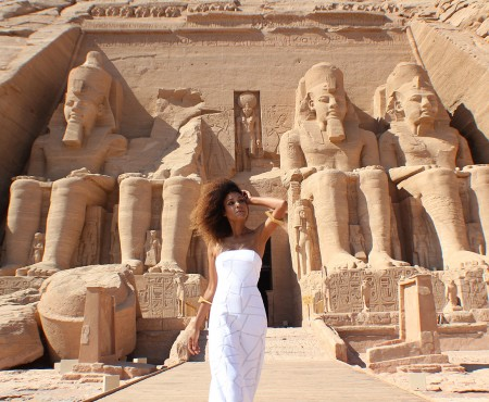 The Global Girl Travels: Ndoema arrives at the Abu Simbel temples in a white strapless maxi dress by Alexis. Photographed in Nubia, southern Egypt, near the border with Sudan.