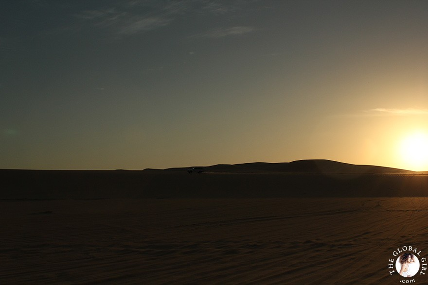 The Global Girl Travels: Sunset over the sand dunes in the Great Sand Sea, 72,000 km² sand desert region in North Africa stretching between western Egypt and eastern Libya.