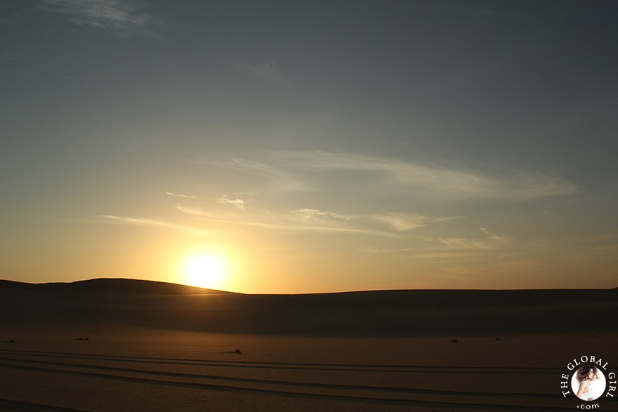 The Global Girl Travels: Sunset over the sand dunes in the Great Sand Sea, a 72,000 km² sand desert region in North Africa stretching between western Egypt and eastern Libya.