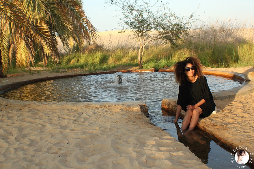 The Global Girl Travels: Desert safari at the beautiful freshwater lake at Bir Wahed, a striking natural landmark on the edge of the Great Sand Sea, 72,000 km² sand desert region in North Africa stretching between western Egypt and eastern Libya.