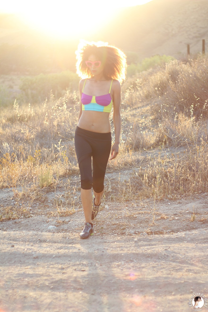 The Global Girl Daily Style: Ndoema jogs in pink cat eye sunglasses, a color block sports bra and mesh capri leggings by Onzie