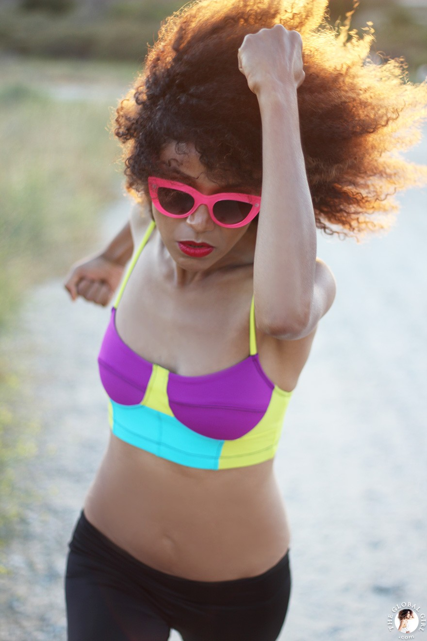The Global Girl Daily Style: Ndoema jogs in pink cat eye sunglasses and a color block sports bra by Onzie