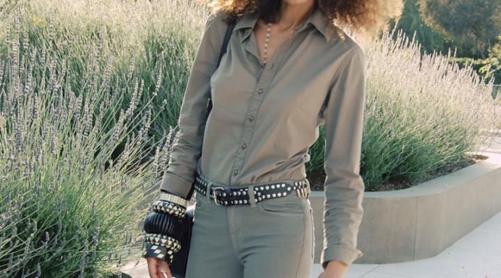 Ndoema wears J Brand jeans in khaki, G-Star Raw Denim shirt, l.a.m.b. platform sandals, classic dooney bourke leather handbag and large ethnic black and white horn and wood bracelets.