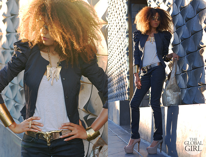 The Global Girl Daily Style: Ndoema sports a puff-sleeve jacket by Elizabeth And James, Stella McCartney straight leg jeans, Betsey Johnson suede platform pumps, custom brass cuff bracelets, vintage elephant head pendant, gold metallic hobo bag, Christian Roth gold mirrored sunglasses and vintage brass cow skull belt.