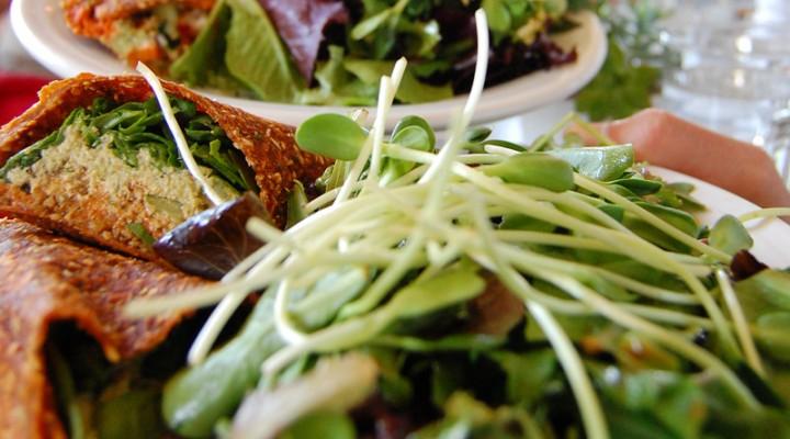 "Raw vegan Mediterranean wrap with live falafels at vegan restaurant Cafe Gratitude in Venice, California."" border=""0"" />"