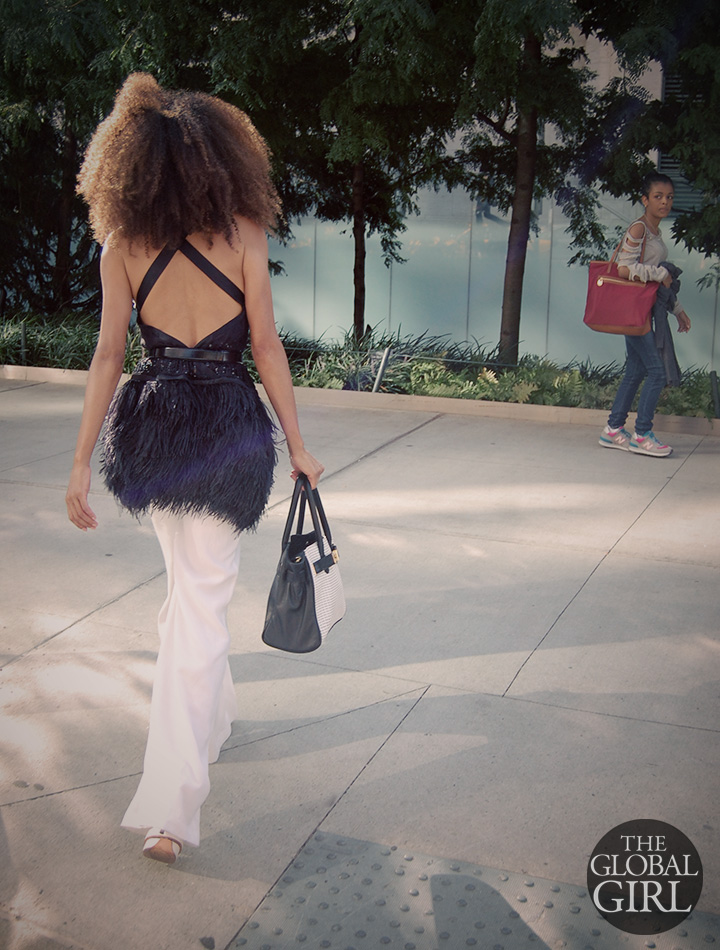 The Global Girl Daily Style: Ndoema rocks the classic Black & White look on day 1 of New York Fashion Week with a feather-embellished backless silk top by Bebe, white wide leg pants by Cynthia Vincent and Black & White laser cut leather handbag by Onna Ehrlich.