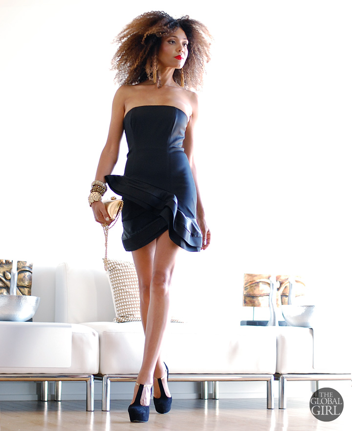 The Global Girl Daily Style: Ndoema rocks the classic little black dress in a Alice + Olivia strapless number with gold tassel earrings, a gold metallic box clutch, gold skull ring and black suede platform pumps.