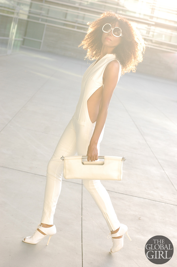 Ndoema channels Sun Girl Selah Burke in all white look: cutout jumpsuit from Son Jung Wang Spring 2014 runway collection   White frame oversized sunglasses by Balenciaga   White cutout lace-up sandals by Helmut Lang   White leather bag by Prada.