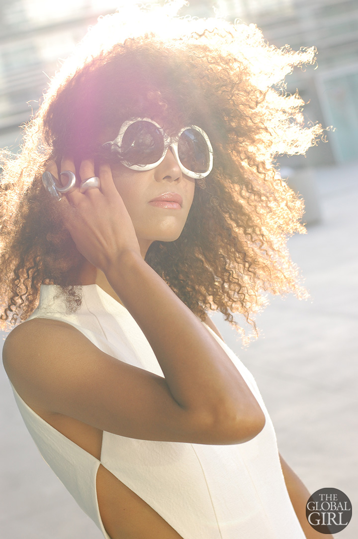 The Global Girl Fashion Editorials: Ndoema rocks a white cut out jumpsuit and oversized Balenciaga sunglasses.