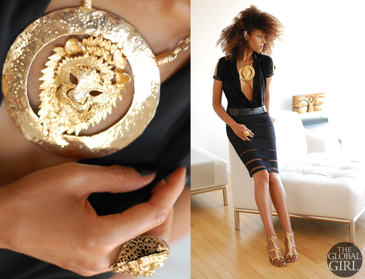 The Global Girl Daily Style: Ndoema rocks the black and gold look in a Versace pencil skirt and Richard Tyler Couture top with plunging neckline and cutout sleeve, accessorized with gold oversized lion necklace, gold lion ring and gold fan ear cuff with gladiator sandals by Sigerson Morrison.