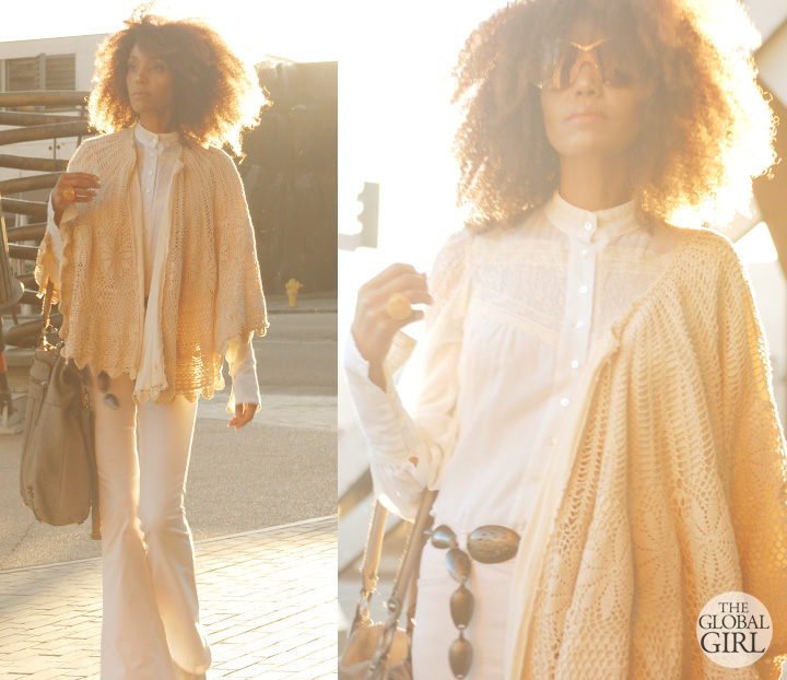 The Global Girl Daily Style: Ndoema rocks a seventies inspired boho look in J Brand bell bottom jeans, a vintage crochet cape, Pour La Victoire platform booties, Vintage Victorian lace blouse, Linea Pelle leather tote and Vintage oversized monobrow shield sunglasses.
